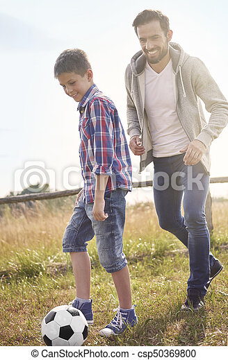 Father playing football with his son - csp50369800