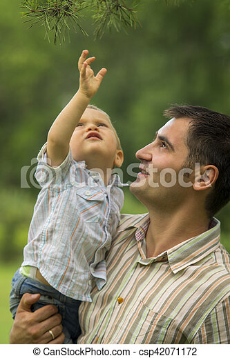 Father with baby son in park - csp42071172
