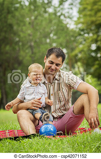 Father with baby son in park - csp42071152