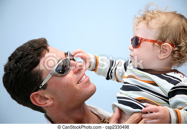 father with the child in the sunglasses against the background of the sky - csp2330498