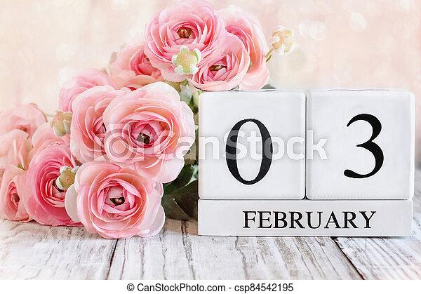 February 03 Calendar Blocks with Pink Ranunculus - csp84542195
