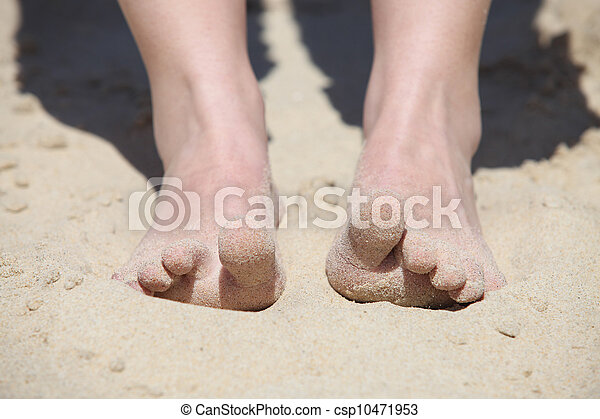 Feet digging into the sand - csp10471953