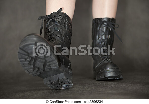 Feet in black leather army boots - csp2896234