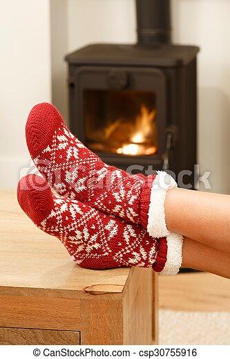 Feet in Christmas socks - csp30755916