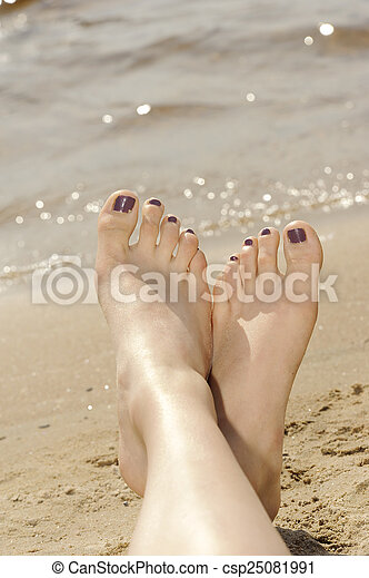 Feet in sand on the beach - csp25081991