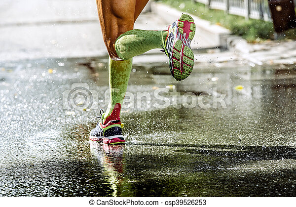 44372f89a7 Feet men runner compression socks, running through a puddle, water ...