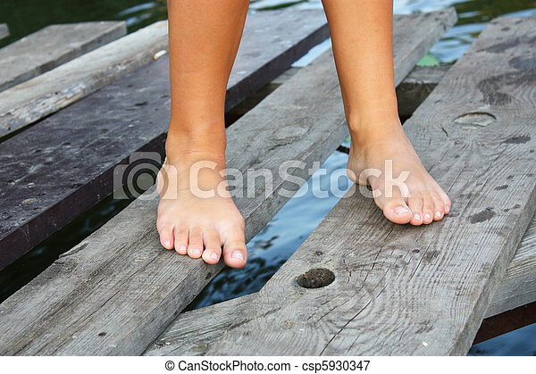 feet of the girl feet of the young girl the girl stends on the