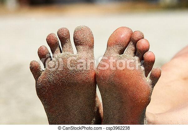 Feet of woman lying on the beach - csp3962238