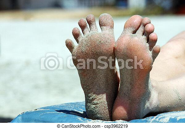 Feet of woman lying on the beach - csp3962219