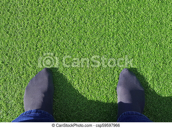 feet on synthetic or artificial grass - csp59597966