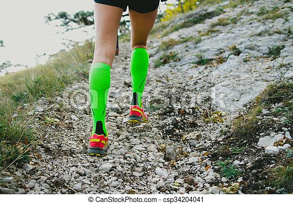 dc56fb400 Feet running girls. Closeup of slender and beautiful legs girl ...