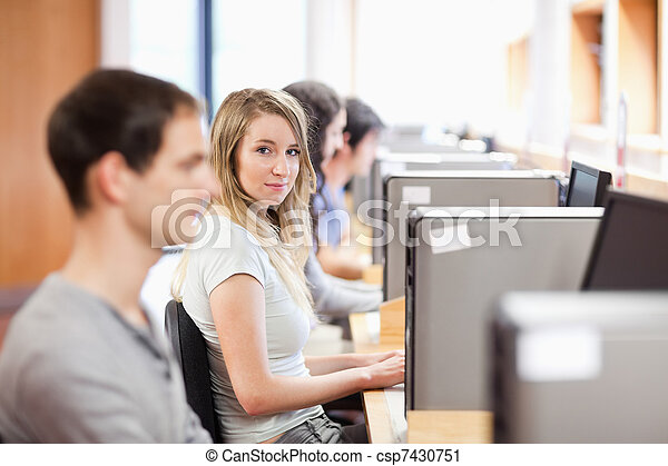 Fellow students using a computer - csp7430751