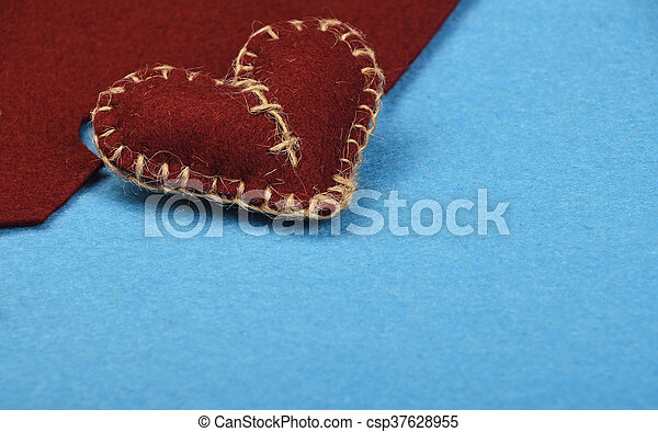 Felt craft and art brown heart cut out on blue - csp37628955