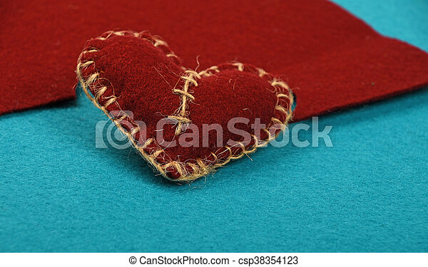 Felt craft and art brown heart cut out on blue - csp38354123