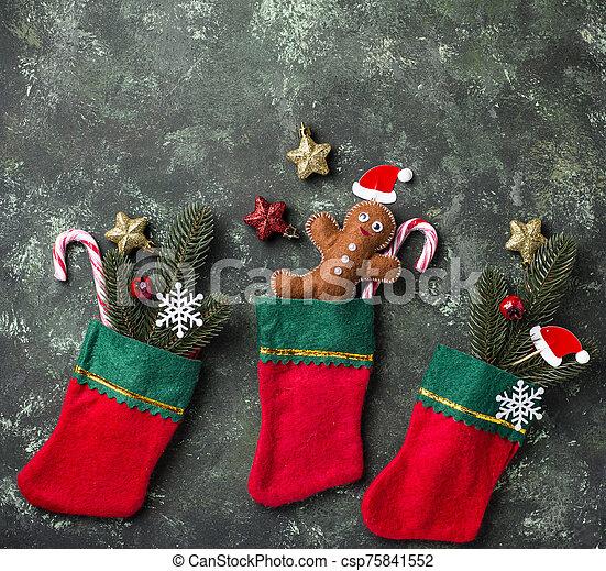 Felt gingerbread man in socks - csp75841552