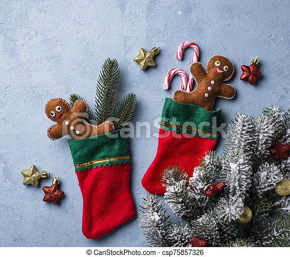 Felt gingerbread man in socks - csp75857326