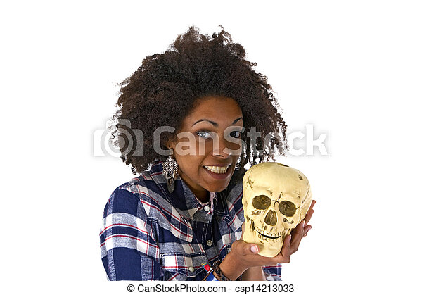 Female afro american woman with human skull model - csp14213033