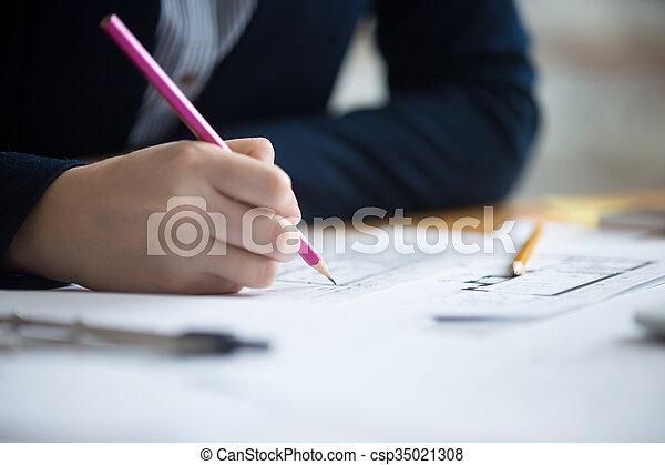 Female architect drawing - csp35021308