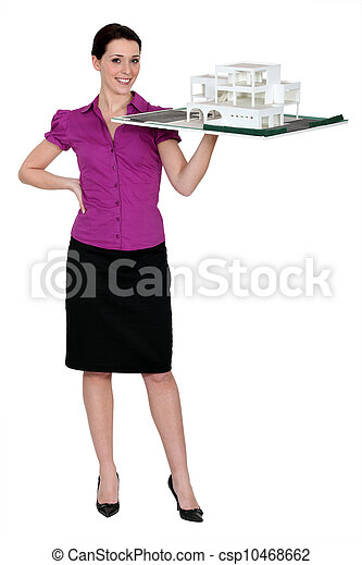 Female architect holding holding scale model of project - csp10468662