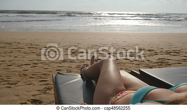 Female Body On Chaise Longue Relaxing And Enjoying During Summer Vacation Empty Sandy Ocean Beach Young Woman Lying Sunbed By The Sea Tanning