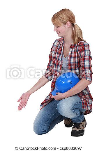 Female builder gesturing - csp8833697
