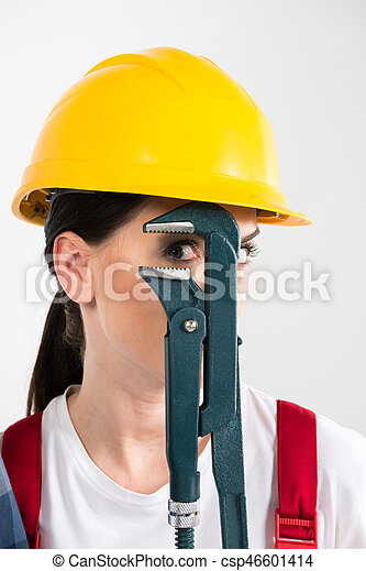 Female builder holding wrench - csp46601414