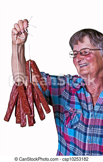 female butcher with smoked sausage - csp10253182