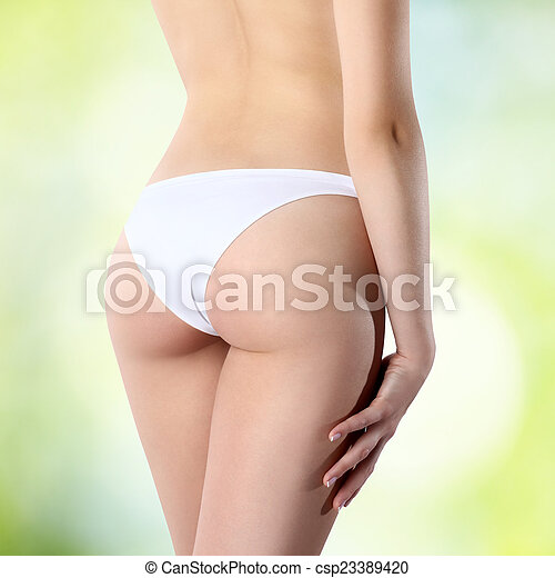 Female Buttocks In White Panties On A Green Background Csp23389420