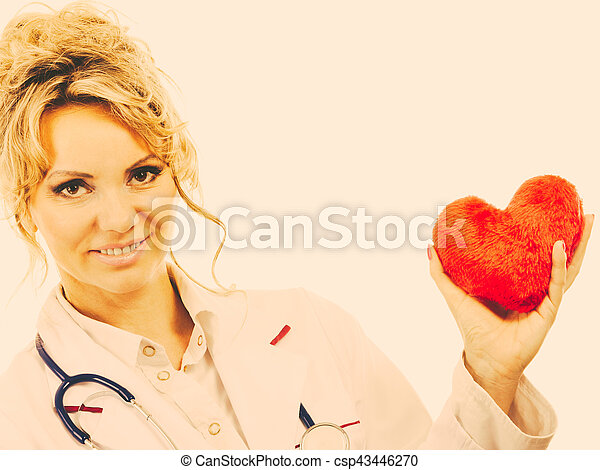 Female cardiologist with red heart. - csp43446270