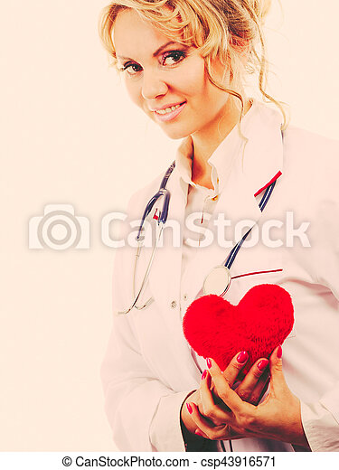 Female cardiologist with red heart. - csp43916571