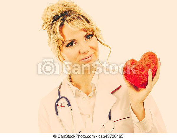 Female cardiologist with red heart. - csp43720465