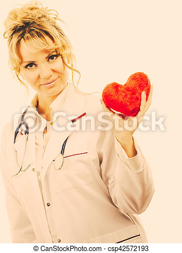 Female cardiologist with red heart. - csp42572193