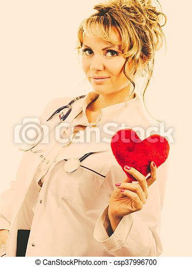 Female cardiologist with red heart. - csp37996700