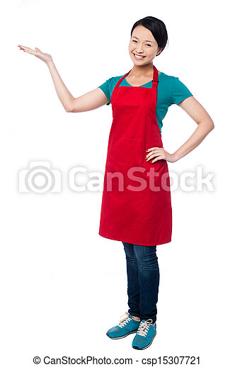 Female chef promoting bakery product - csp15307721