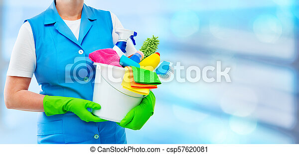 Female cleaner holding a bucket with cleaning supplies - csp57620081