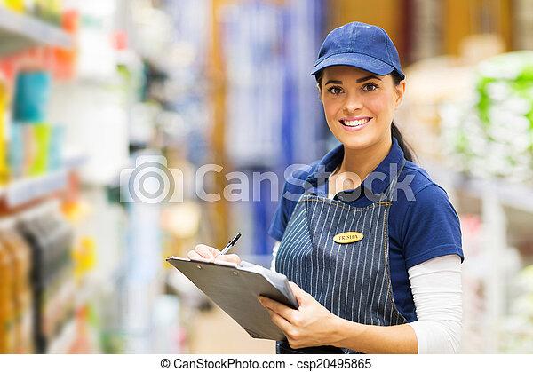 female clerk working in supermarket - csp20495865
