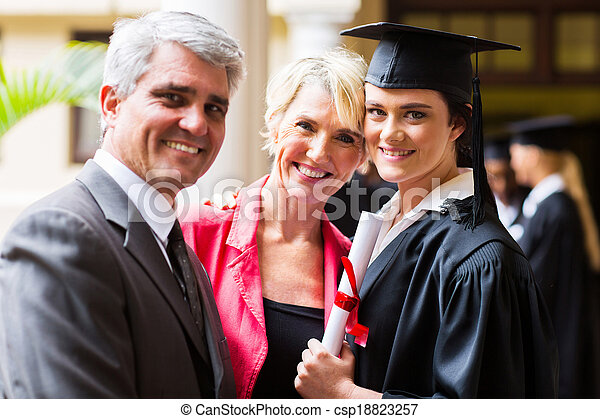 female college graduate with parents - csp18823257