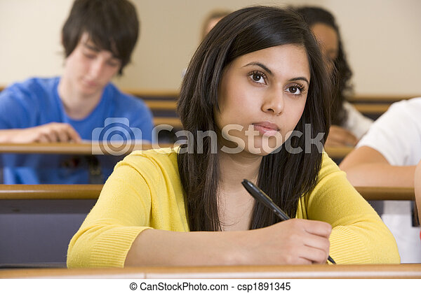 Female college student listening to a university lecture - csp1891345