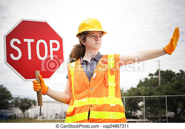 Female Construction Worker Directs Traffic - csp24867311
