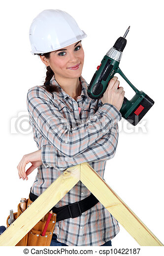 Female construction worker holding a battery-powered screwdriver - csp10422187