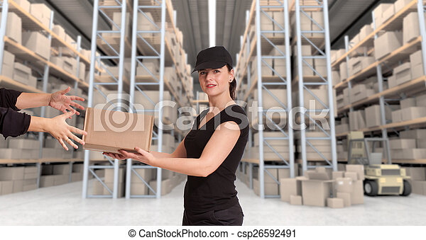 Female courier at distribution warehouse a - csp26592491