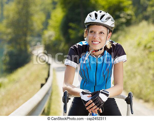 female cyclist - csp2452311