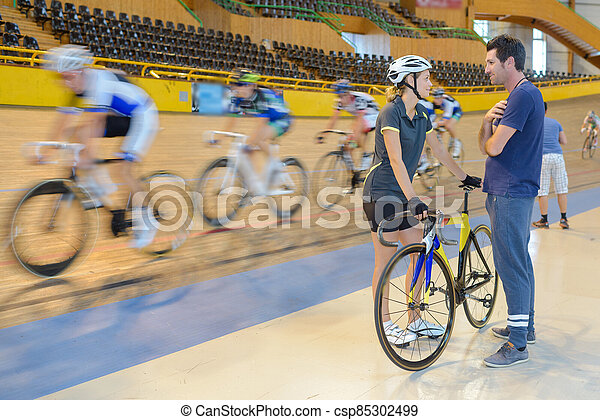 female cyclists in a velodrome - csp85302499