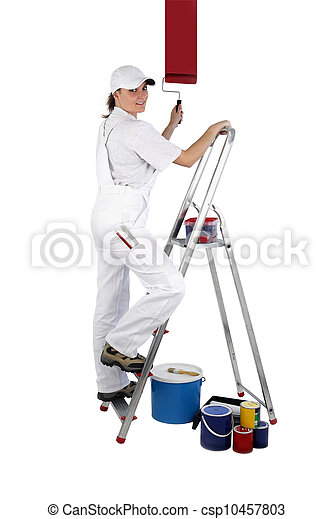 Female decorator painting a wall - csp10457803