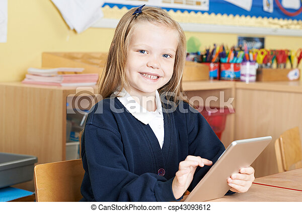 Female Elementary School Pupil Using Digital Tablet In Class - csp43093612