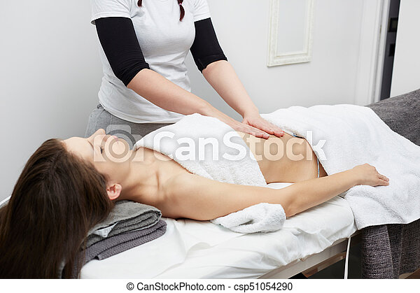 Female Enjoying Relaxing Belly Massage In Cosmetology Spa Center - csp51054290
