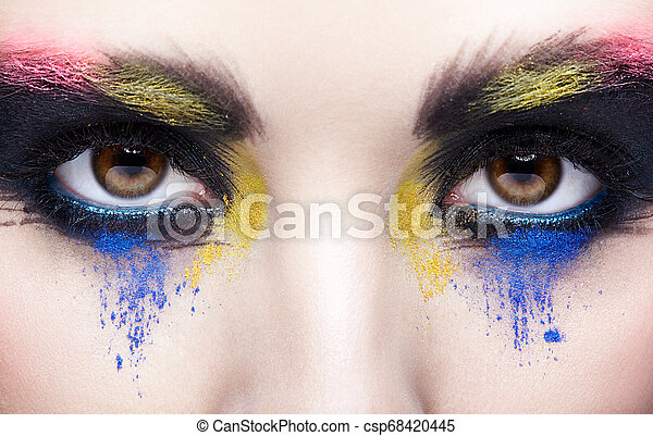 Female eye with unusual artistic painting makeup - csp68420445