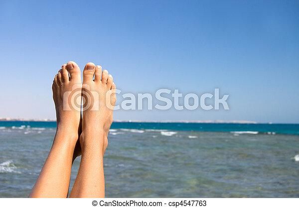 Female feet against the sea - csp4547763