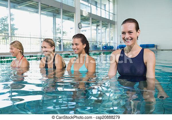 Female fitness class doing aqua aerobics - csp20888279