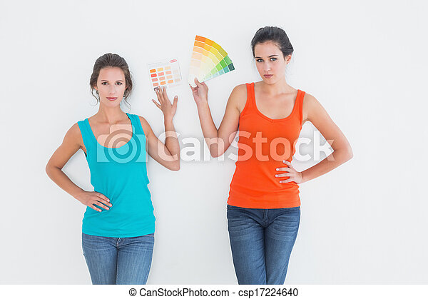 Female friends choosing color for painting a room - csp17224640